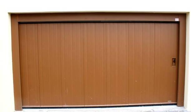 Porte coulissante articul e habitat mischler en ligne for Porte de garage mischler