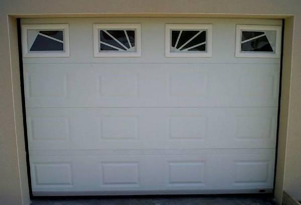 Porte sectionnelle type cassette habitat dimensions hors for Porte de garage mischler